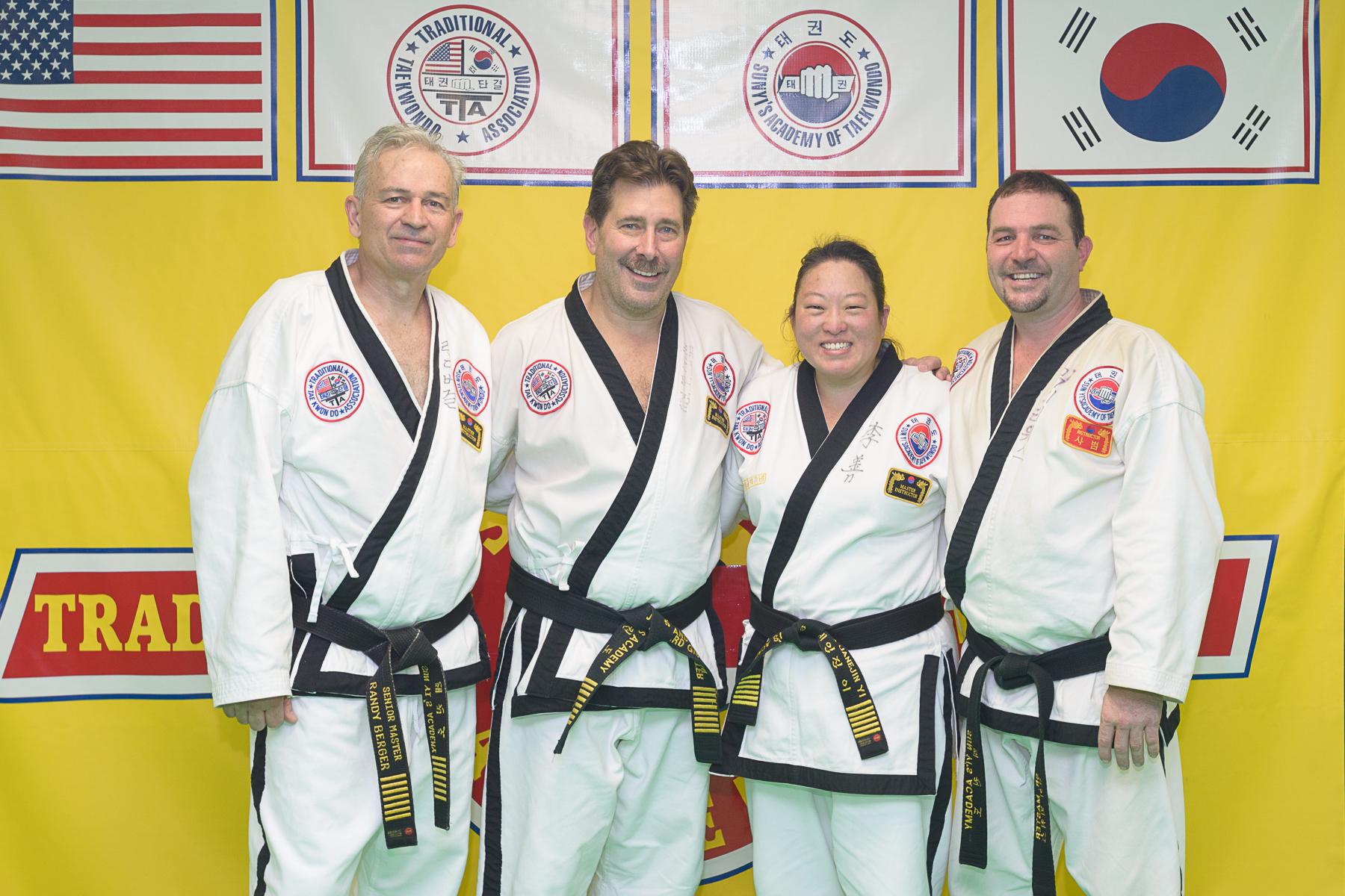 Jr. Grand Masters and Senior Master at Sun Yi's Academy
