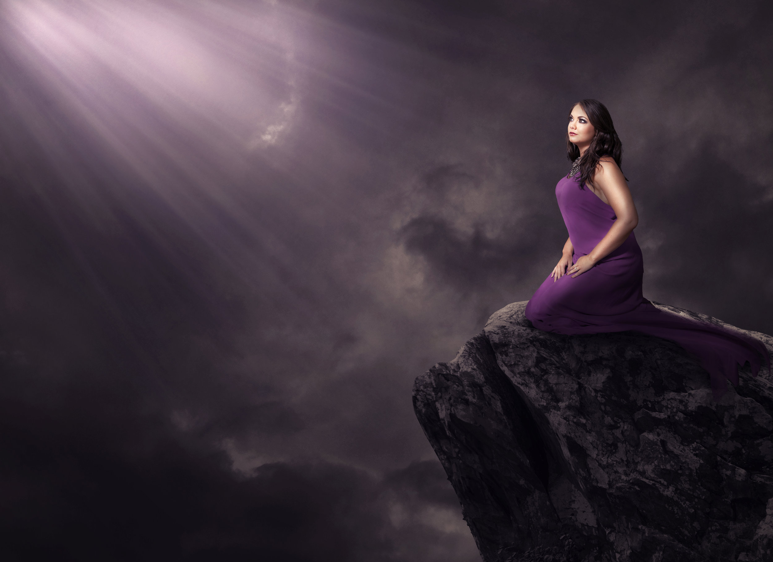 a-woman-alone-on-a-cliff-under-glowing-lights_SjoBBhKIPx.jpg