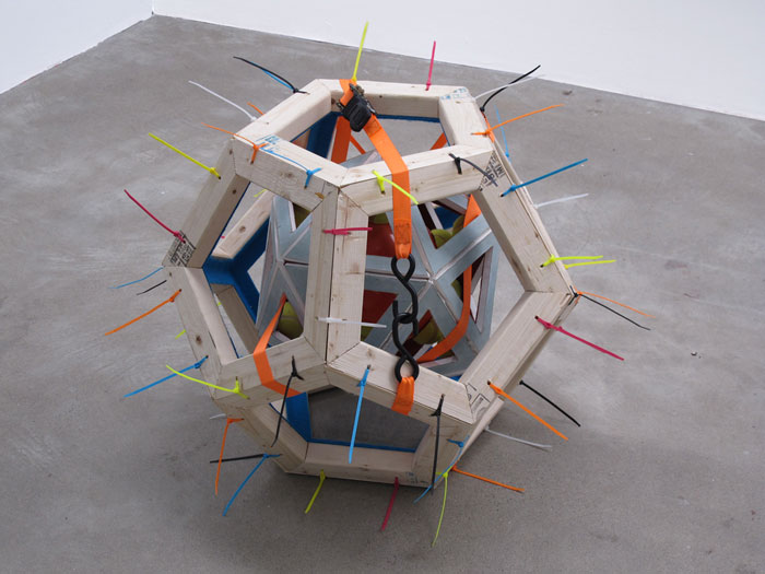 Shaun Flynn,  I Was Up Above It, But Now I'm Down In It , 2012, wood, drywall, felt, cable ties, tennis balls, organe play ball, ratchet strap, 36 x 36 x 36 in