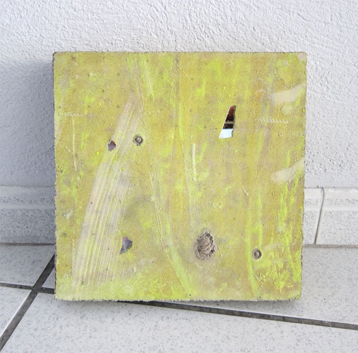 Davina Semo, WHEN SHE REALLY DIDN'T KNOW WHAT TO DO WITH HERSELF, SHE HAD LEARNED TO DO NOTHING AT ALL , 2012,spray paint transfer on reinforced concrete, peach pit, mirror,10 x 10 in