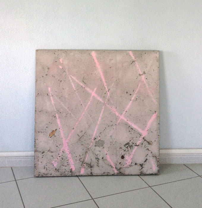 Davina Semo, THE GIRL SMILED, BUT HER SMILE WAS PURSUING A DIFFERENT CONVERSATION , 2012,spray paint transfer on reinforced concrete, tempered glass, rosebush stems, peach pit, cherry pits, rock,35.5 x 35.5 x 1.8 in