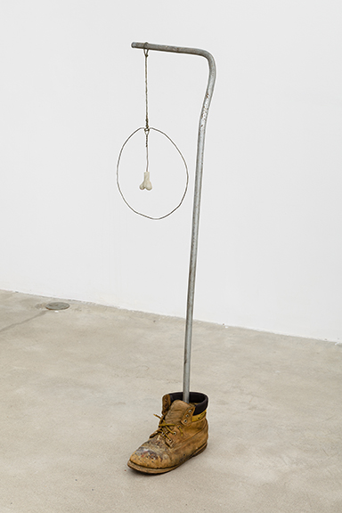 Alex DeCarli,  Untitled (figure),  2012, concrete, electrical conduit, work boot, wire hanger, 44 x 15 x 10 in