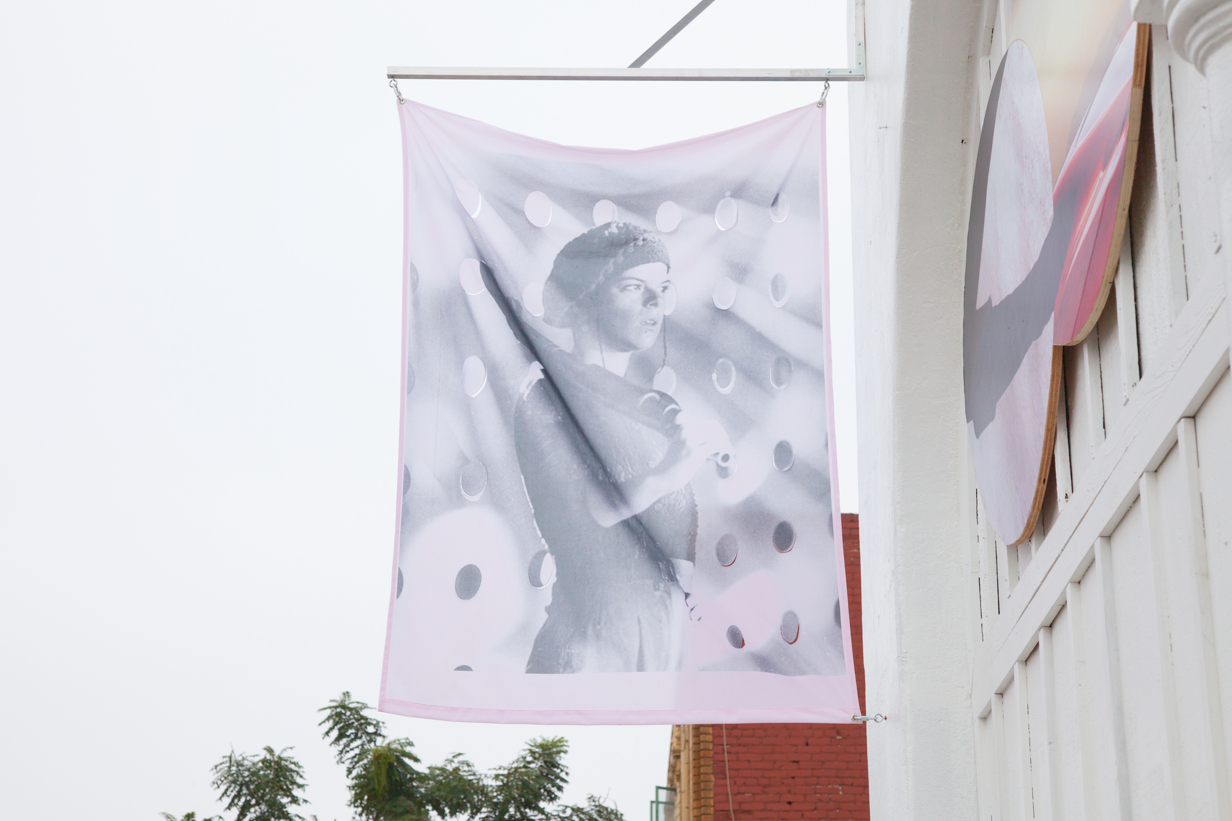 Servane Mary, Untitled (Woman With Gun) , 2012, reversible pigment printed vinyl, 67 x 47.5 in