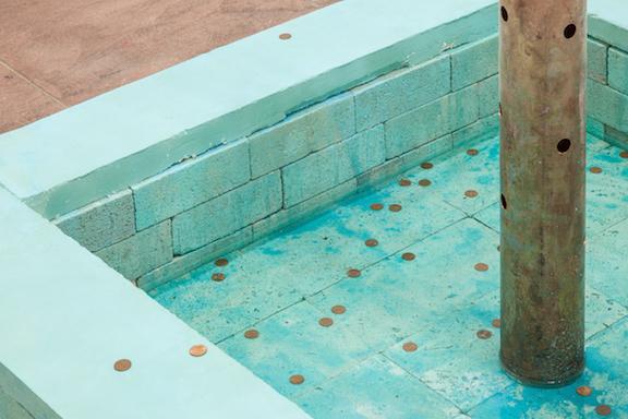 Jory Rabinovitz, EBB  (detail), 2014, melted pennies, pennies, Verdigris, bricks, rain water, dimensions variable