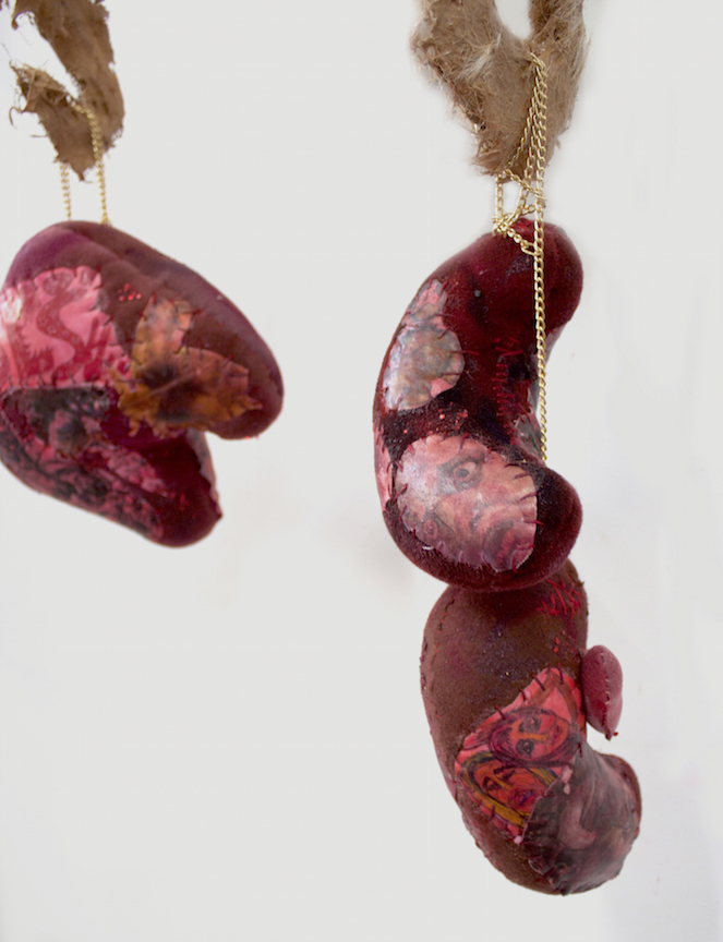 Athena Papadopoulos, Awful Offal And Foul Fowl, Pricked, Pimped And Plumped (Racks IV & V) (detail),2016,hair dye, nail polish, lipstick, Pepto Bismol, red wine on padding/wadding, image transfer on fabric, jewelry chains, stuffing, pine wood dowels, butcher hooks covered in resin-based glue Mixed with Self Tanner and Synthetic Hair clippings, alligator claws coated in resin and nail polish, leather, various objects encapsulated in pigmented polyester resin, waste pipe, wood and screws, dimensions variable