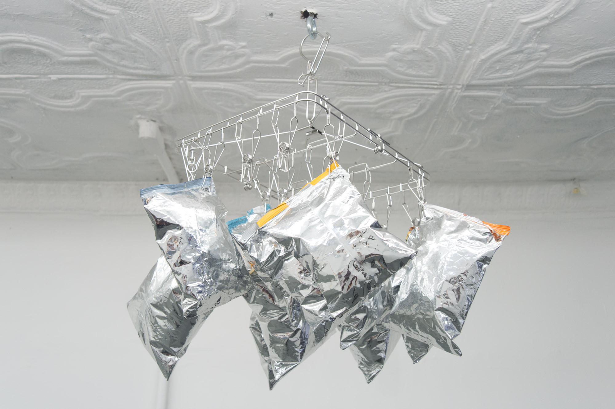 Mieko Meguro, Exhausted Helium Homage to Andy Warhol after Nobutaka Aozaki , 2016, aluminum hardware, cotton batting, potato chip bags,22 × 22 × 19 in