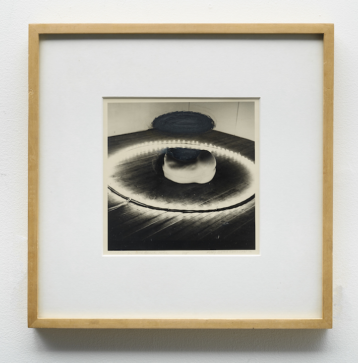 Mary Beth Edelson,  One Black Hole , 1975, ink on silver gelatin print, 12.5 × 12.5 in