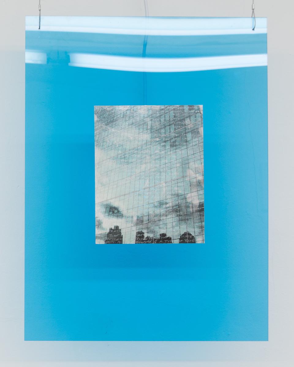 Elizabeth Karp-Evans,   Windowpane (Bryant Park) , 2018, photo transfer on Mylar mounted on plexiglass, colored light, steel wire and artist's text, 23 × 18 in