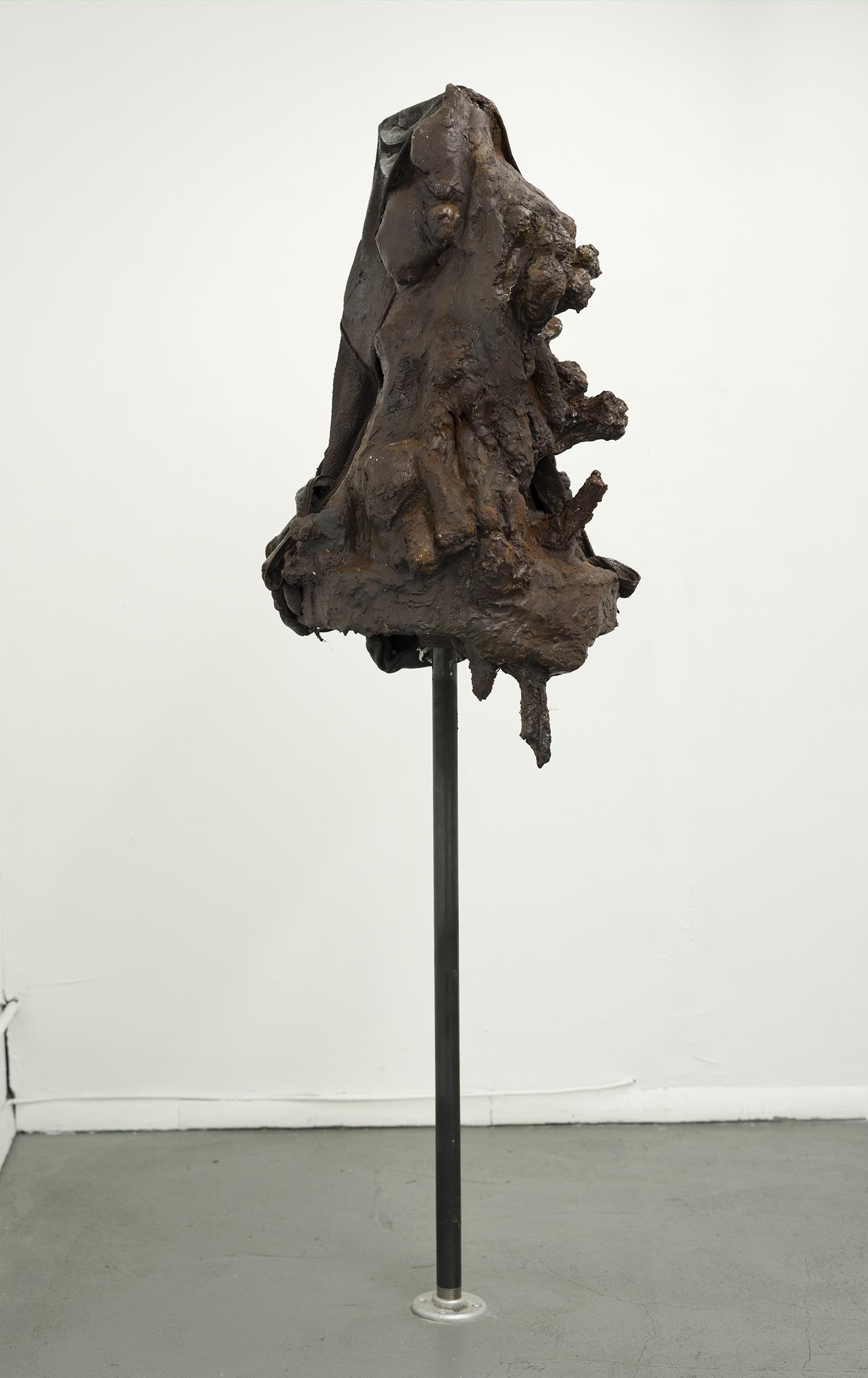 Brandon C Ndife,   The Gleaner , 2018, Cast hydrocal, resin, raw pigment, hooded sweatshirt, steel pipe, 62 × 19 × 17 in