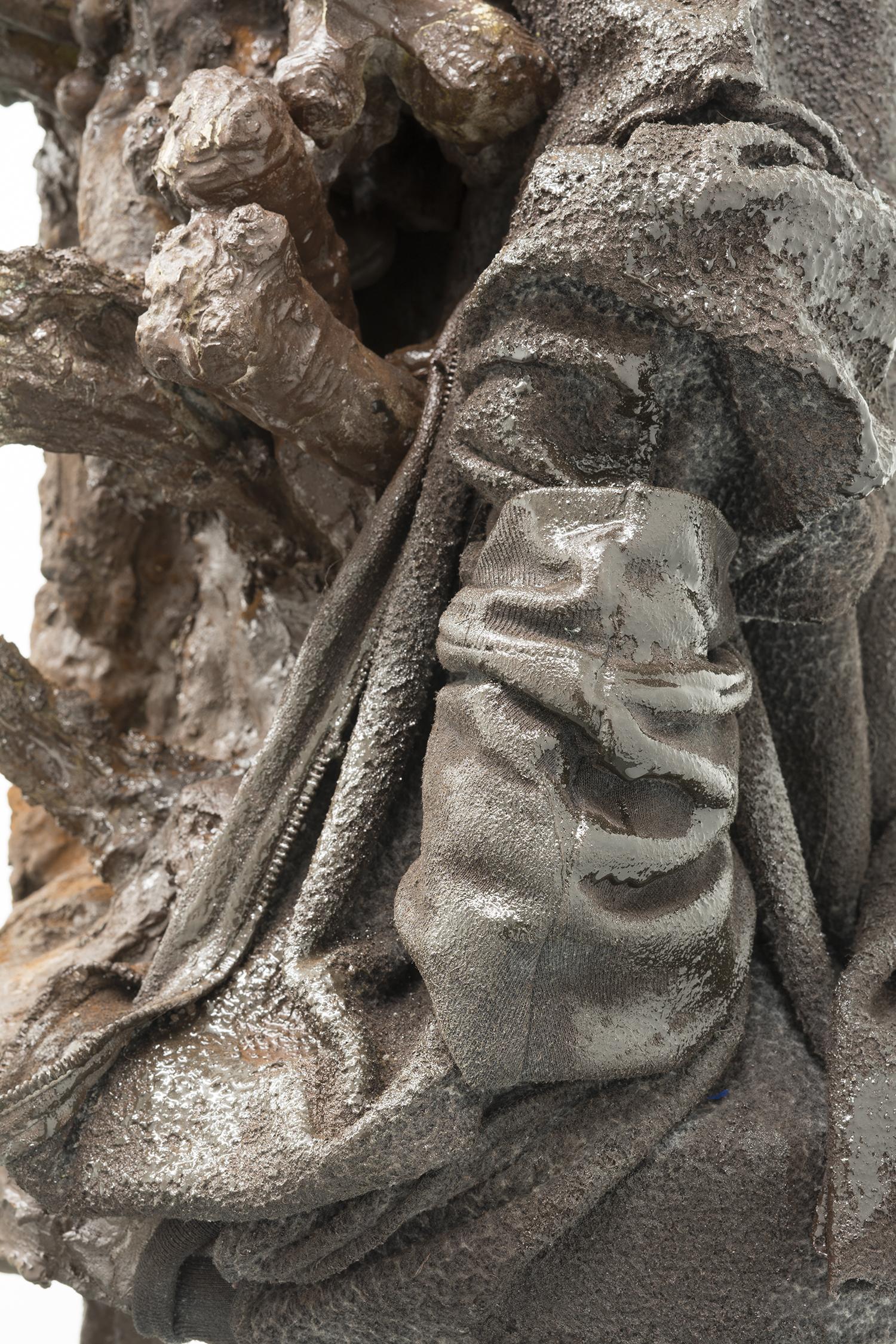 Brandon C Ndife,   The Gleaner  (detail), 2018, Cast hydrocal, resin, raw pigment, hooded sweatshirt, steel pipe, 62 × 19 × 17 in