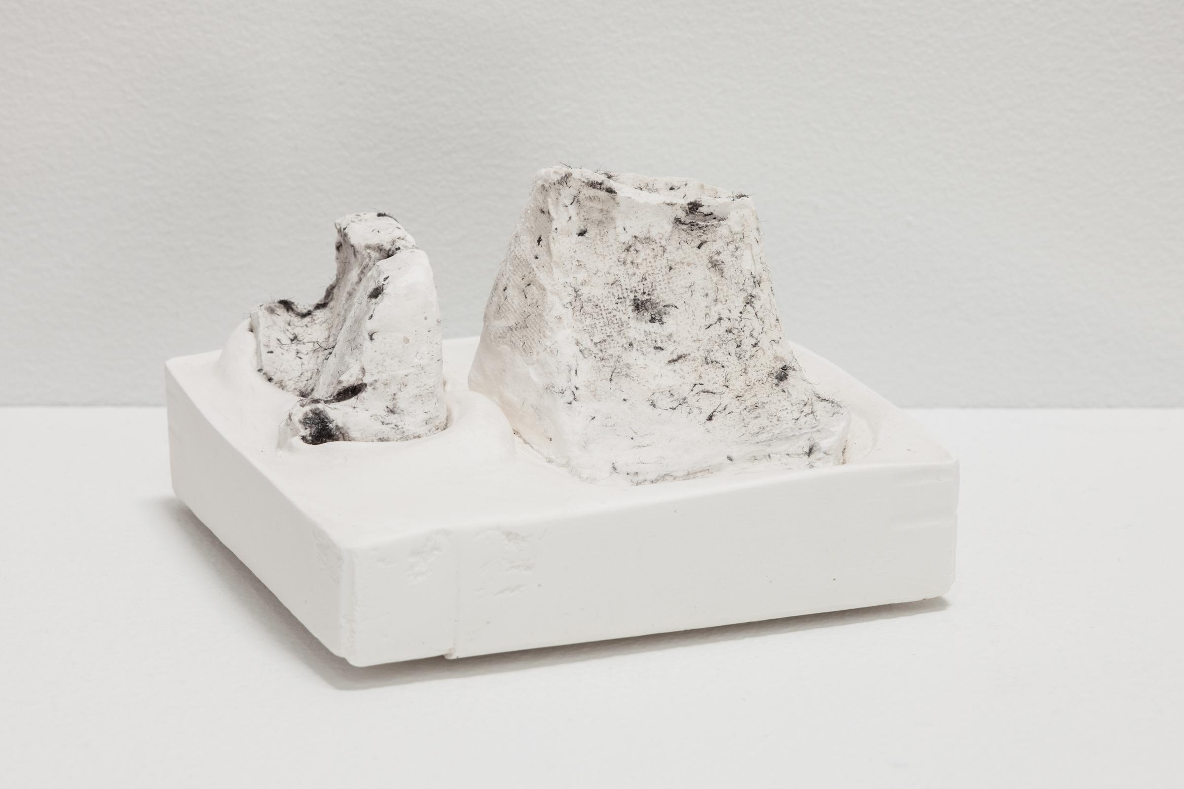 Deborah Hede,  Untitled , 2014, plaster forms, black felt fibers, plaster, 3 × 4 × 4 in
