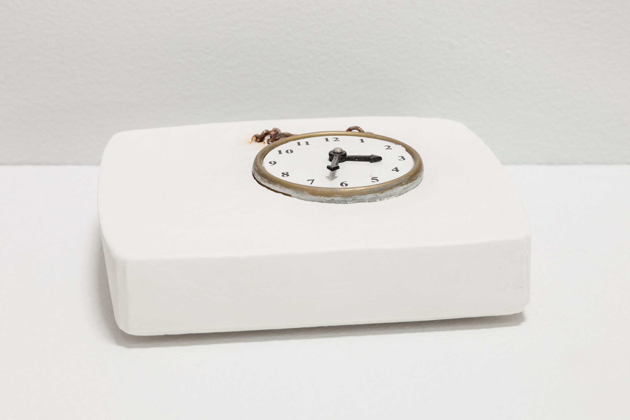 Deborah Hede,  Pocket Watch , 2018, toy watch, plaster, 1 ¼ × 4 × 4 in