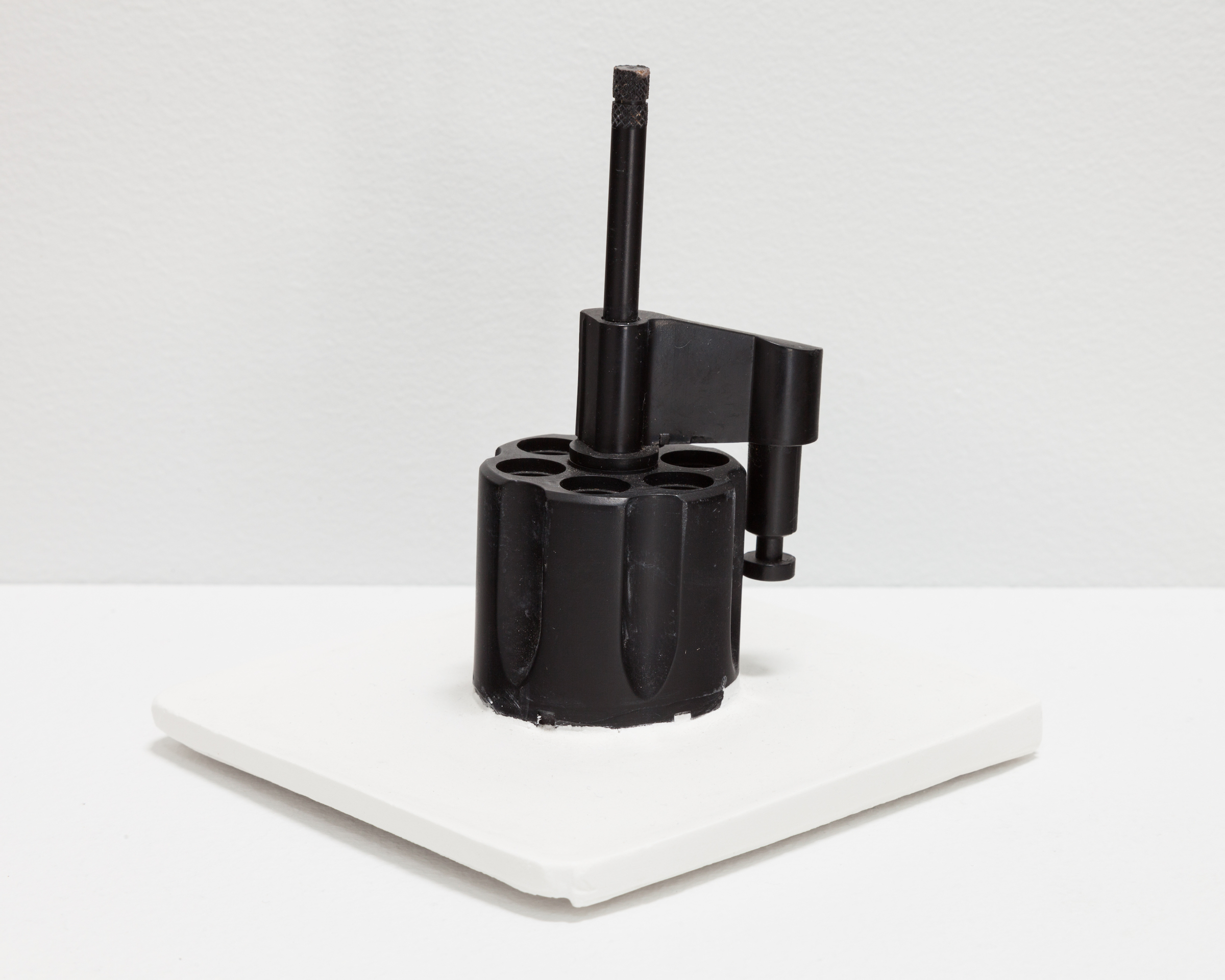 Deborah Hede,  Black Knob with turning mechanism , 2014, unidentified plastic fragment, plaster, 5 × 4 × 4 in