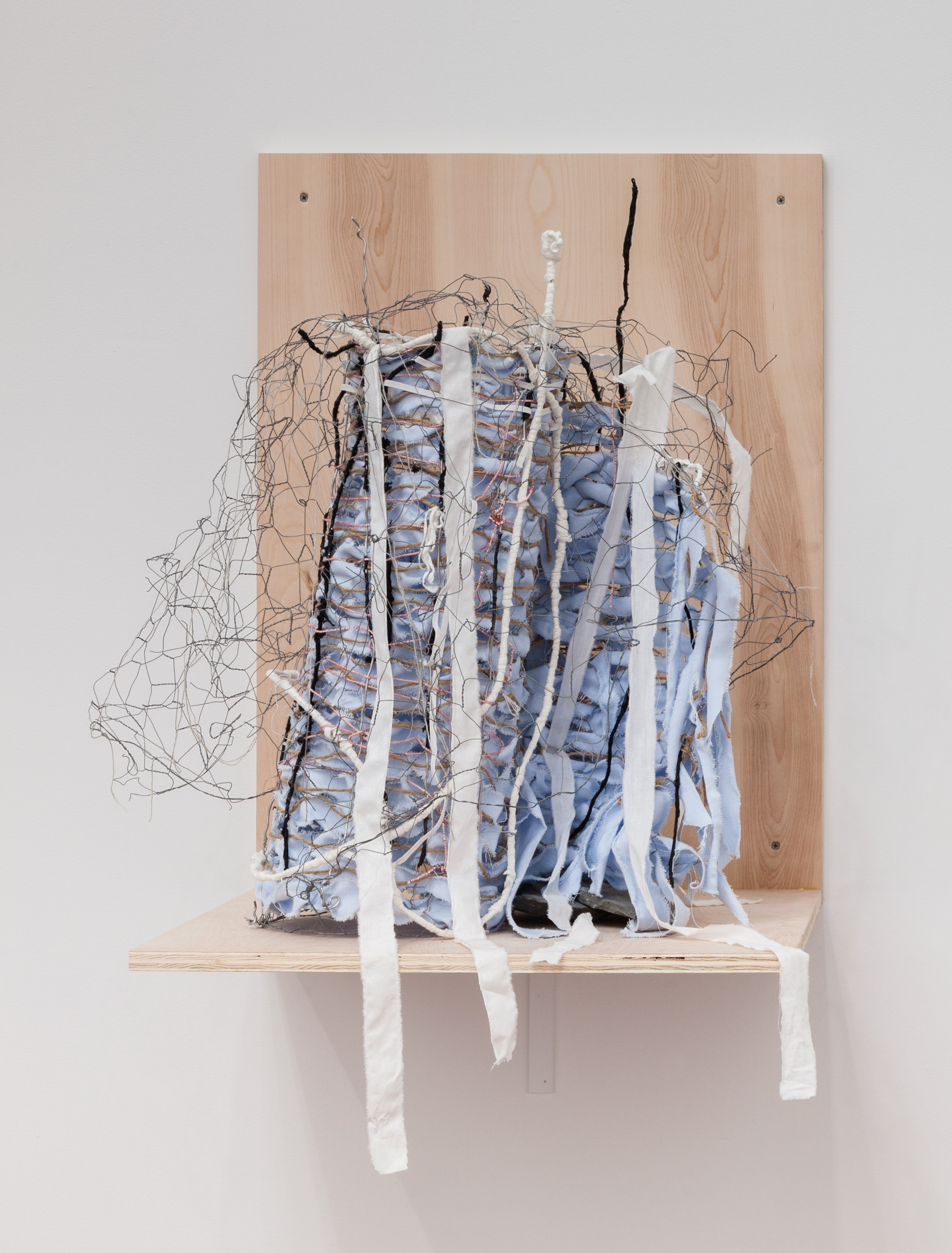 Deborah Hede,    Caged Sculpture , 2017, fencing sections, wire, cloth, paper, elastic, thread, stone, 29 × 29 × 26 in