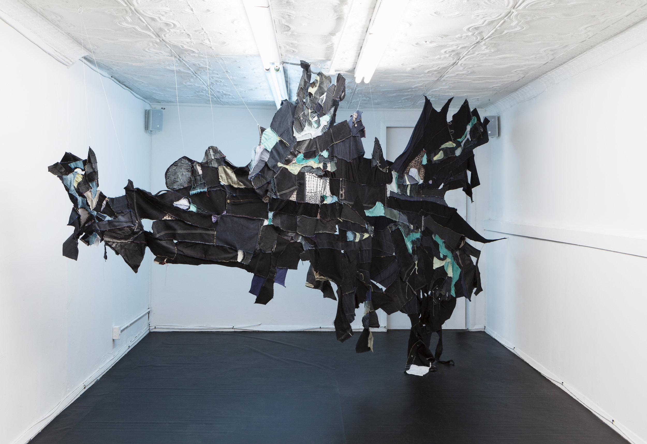 Tau Lewis,  the sighting of the last shadow dweller (original sea kin) , 2018, hand sewn recycled fabrics and leathers