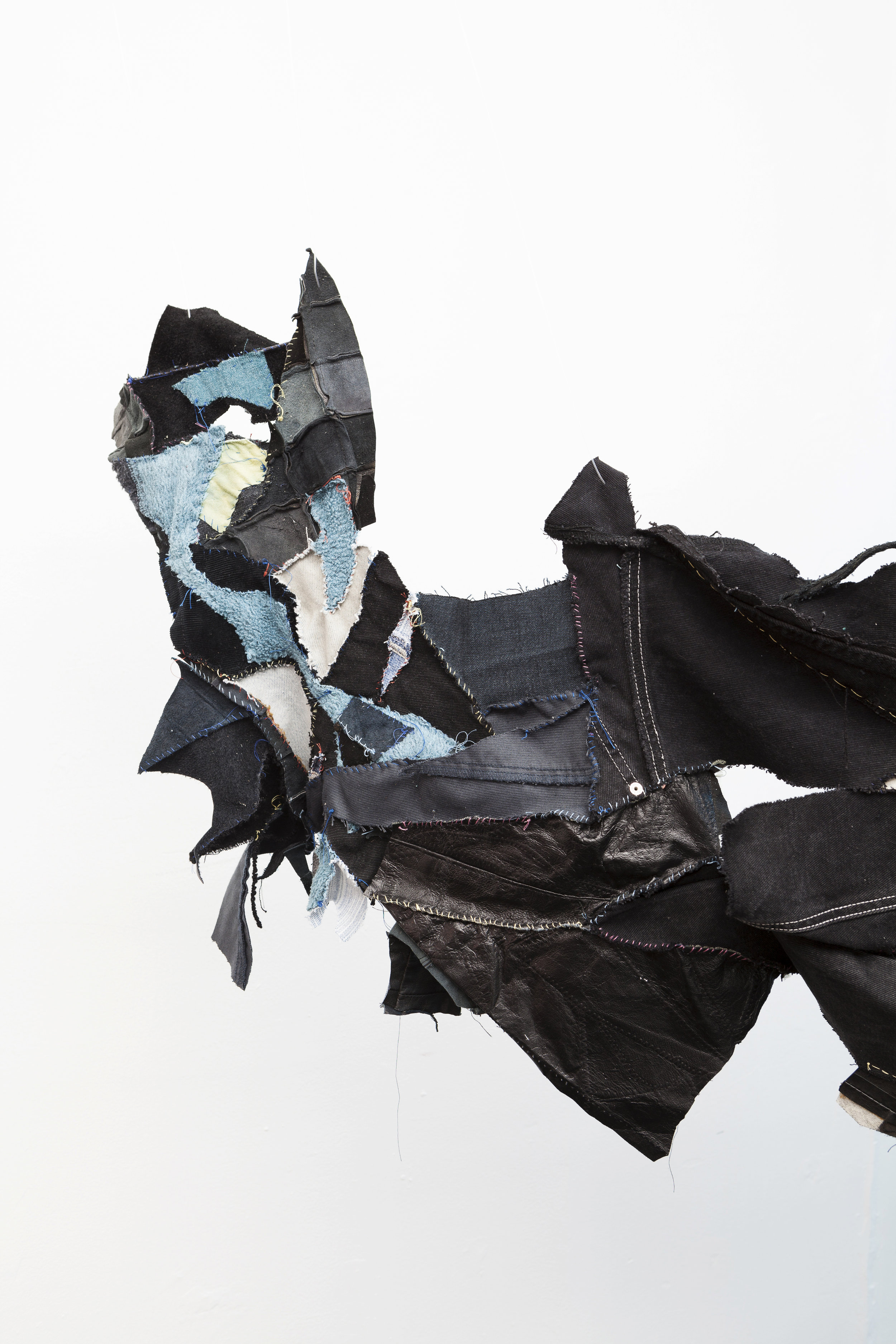 Tau Lewis,  the sighting of the last shadow dweller (original sea kin) , 2018, hand sewn recycled fabrics and leathers (detail)