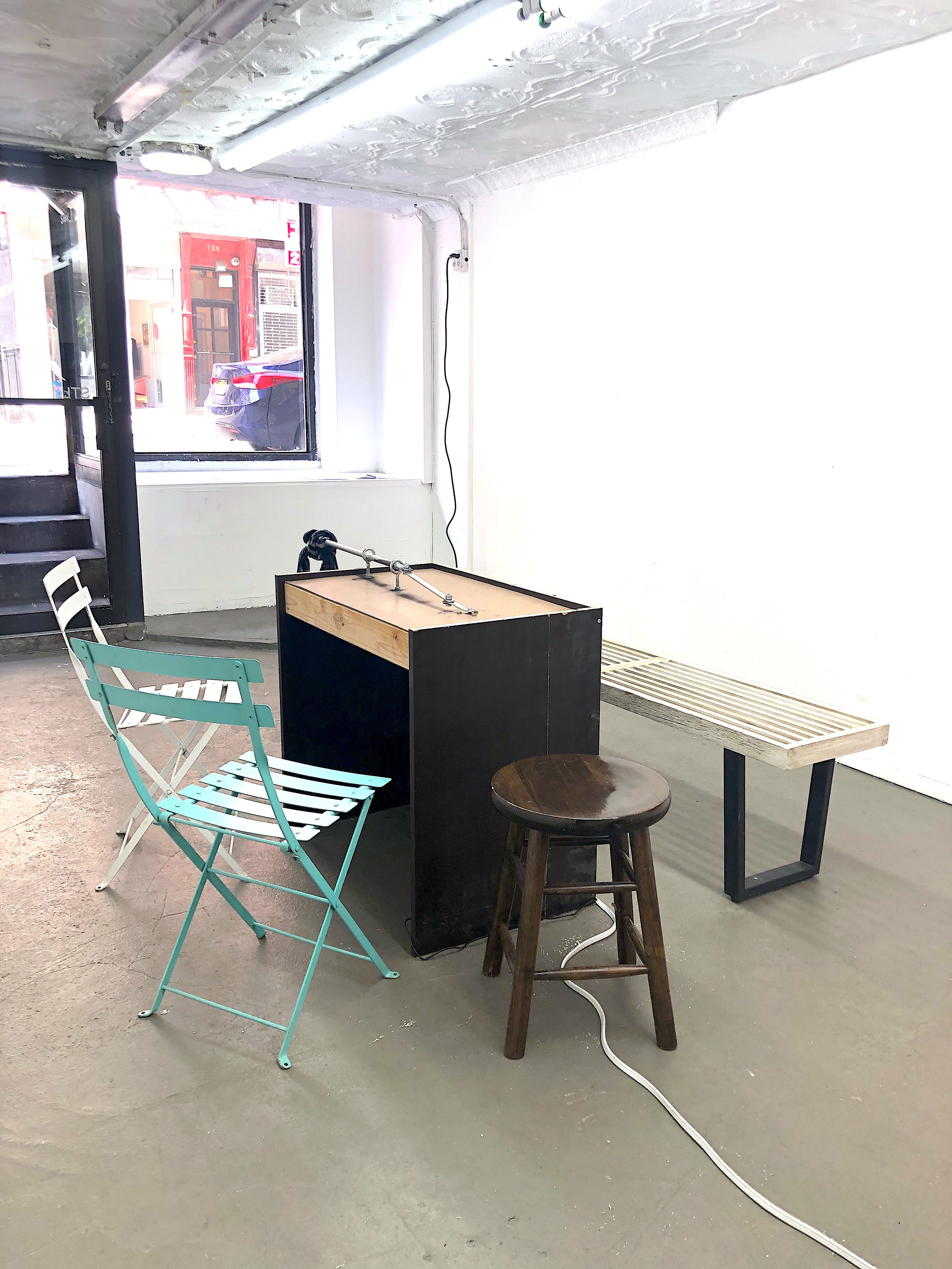 George Egerton-Warburton,  Penal Café: Convict Confidential , 2019, wiper motor, tartan scarf, steel, aluminium, cords, café chairs clandestinely appropriated from/in the style of Australian cafés such as Bluestone lane, Sonnyboy, and Benson's.