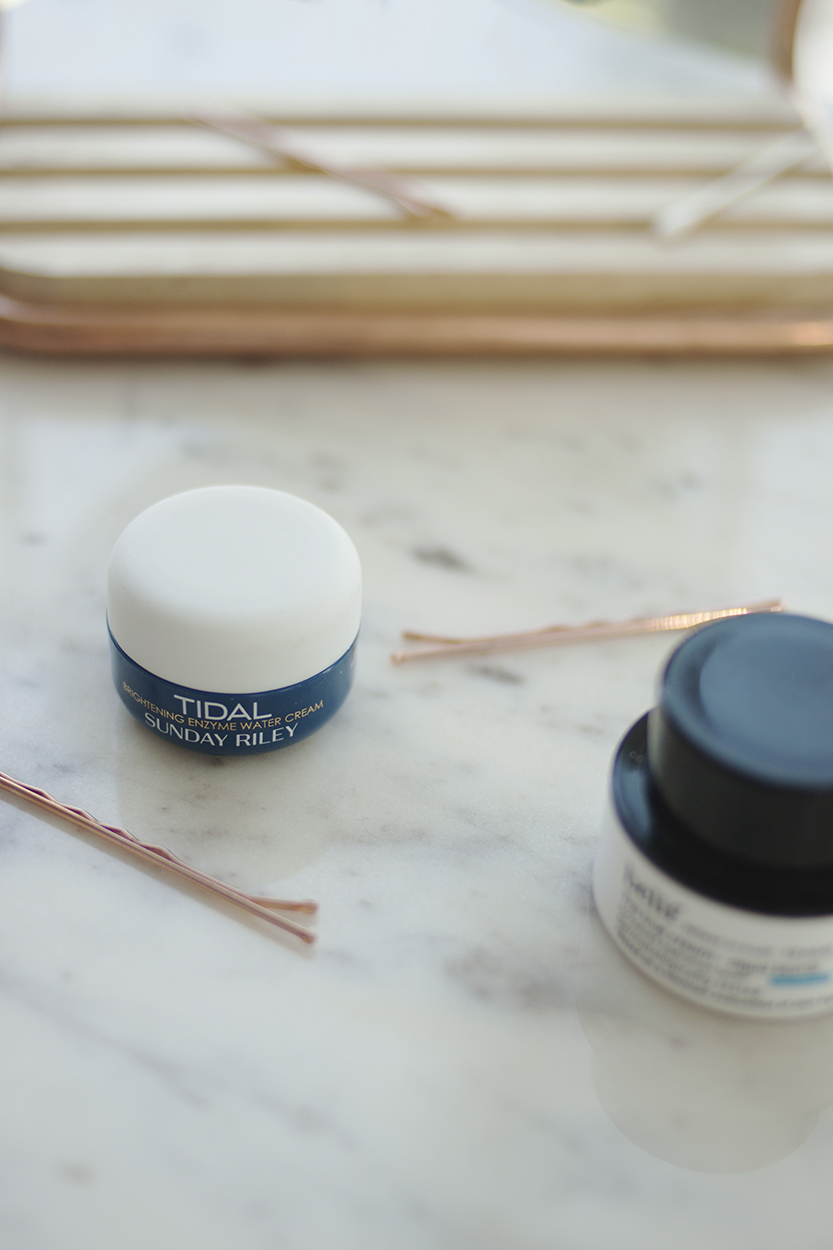 """Sunday Riley Tidal Brightening Enzyme Water Cream - I had a sample of the Sunday Riley Tidal Water Cream (AU) a while back and really enjoyed it, so I was excited to give this another whirl. I wouldn't say it's quite as water-like as either of the Korean ones, but the thicker texture does give it a bit more of a luxurious feel, and I think drier skin types would probably enjoy this more than the other water-creams.At $85 CAD (+ tax) this is the most expensive product in today's line-up. It contains two forms of hyaluronic acid, as well as papaya enzymes which are supposed to exfoliate the skin. I don't personally want my moisturiser to be exfoliating, so I think this is a bit of an odd inclusion. In any case, it's about halfway down the ingredients list, so there's probably not much in there to begin with, and enzymes are a fairly unreliable means of exfoliating because they're not very stable, particularly not in jar packaging like this, so I'm not too worried about them.The thing that makes Tidal different from the others is the inclusion of Alpha-Arbutin at a 1% concentration, which they claim """"aggressively brightens the appearance of hyperpigmentation and dark spots."""" Alpha-Arbutin is proven to be effective, but I'm not entirely convinced that it makes this moisturiser worth the price tag."""