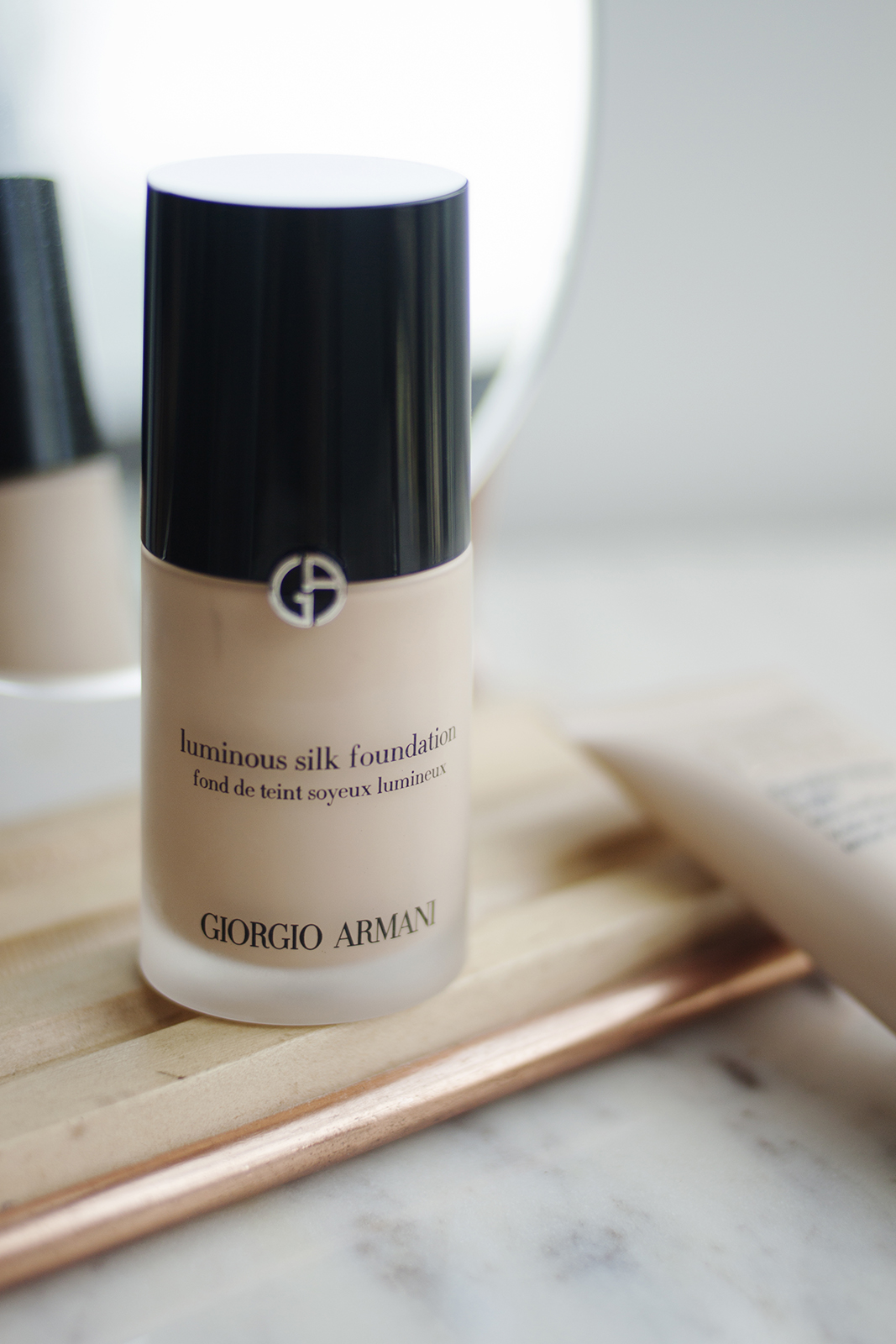 """- While I try not to save makeup products for special occasions, and I do use this whenever I feel like it, in my mind I still think of it as my special occasion foundation because I always reach for it when I want to feel really good. The first time I tried the Giorgio Armani Luminous Silk Foundation (AU) in Shade 2, I immediately understood why it's such a makeup artist favourite and why to this day it still gets so much love online.Again, it's not the best for oily skin, it's not particularly long lasting on its own, but the finish is just so beautiful that it's worth the extra effort for me. I have never put this on my face and been disappointed with how it looks. They released what I believe is supposed to be a longer wearing version called the Power Fabric Foundation, but I tried a sample of it and didn't think it was as beautiful as Luminous Silk, so I'm sticking with the original.It has a decent medium coverage (more than the Bourjois) and could be built up a bit more if that's what you're feeling. But the bottom line is that it looks very natural and beautiful on the skin – definitely a """"your skin but better"""" kind of vibe, which is what makes it a forever favourite for me."""