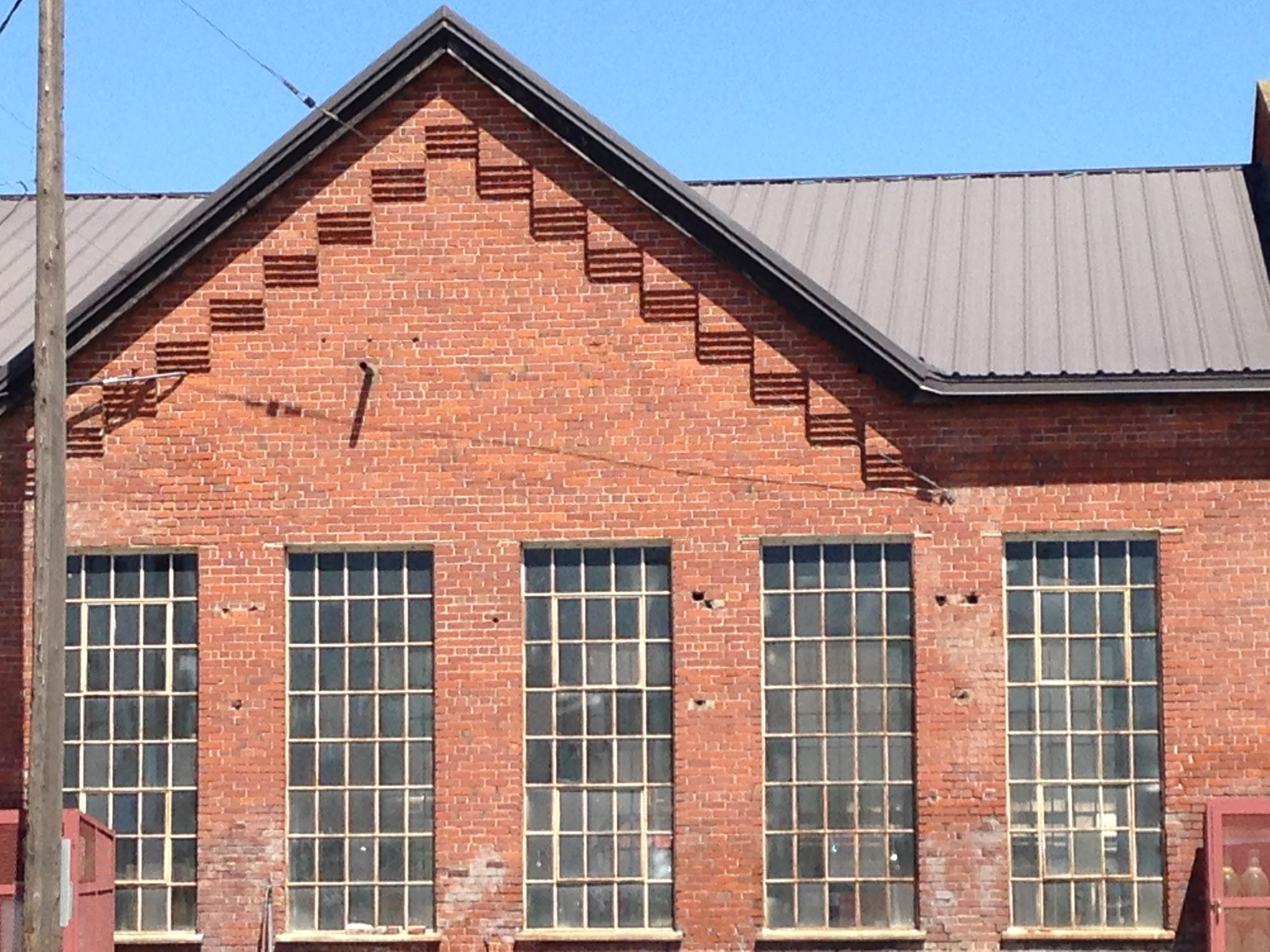 Beautiful brick step detailing along the roof line here.