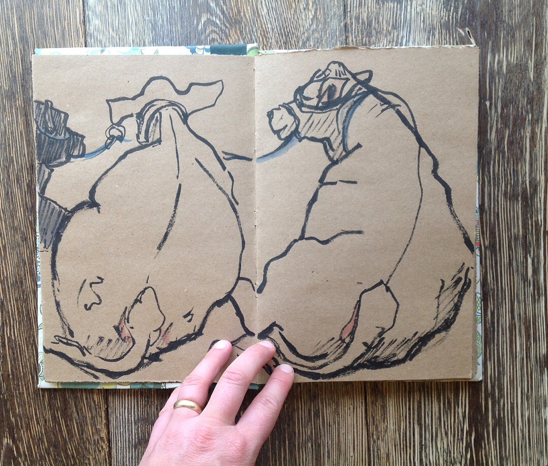 I broke out the brown paper sketchbook to draw some cows, waiting patiently in the barn. They are HUGE.