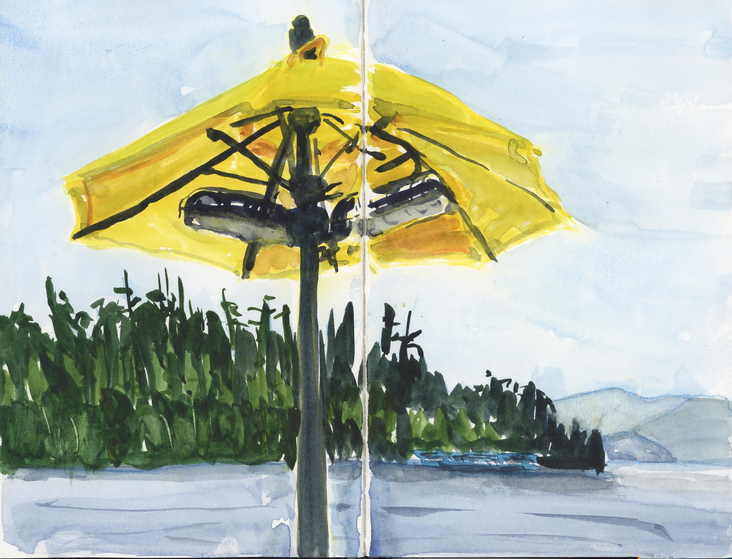 Yellow umbrellas on the deck while eating at Cavanaugh's.