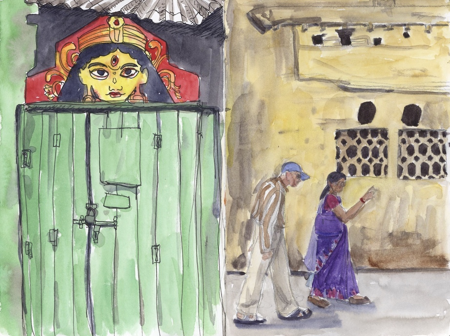 On the left: A doorway with what I think might be Kali over looking it and on the right, an older couple walking in front of a worn wall.