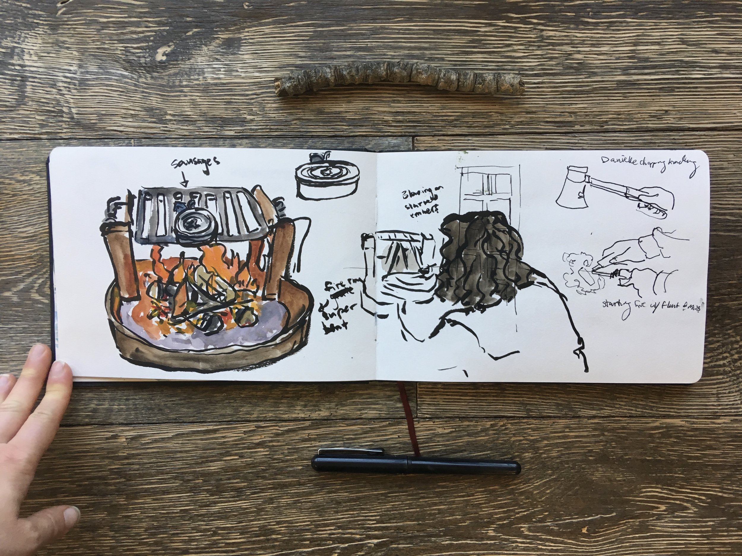 More camping adventures with Danielle doing the work and I sketch. 😄😝 I drew her progress from right to left across the pages and she started a fire with flint and tinder, split wood for smaller slivers and built the fire into something to cook our sausages on!