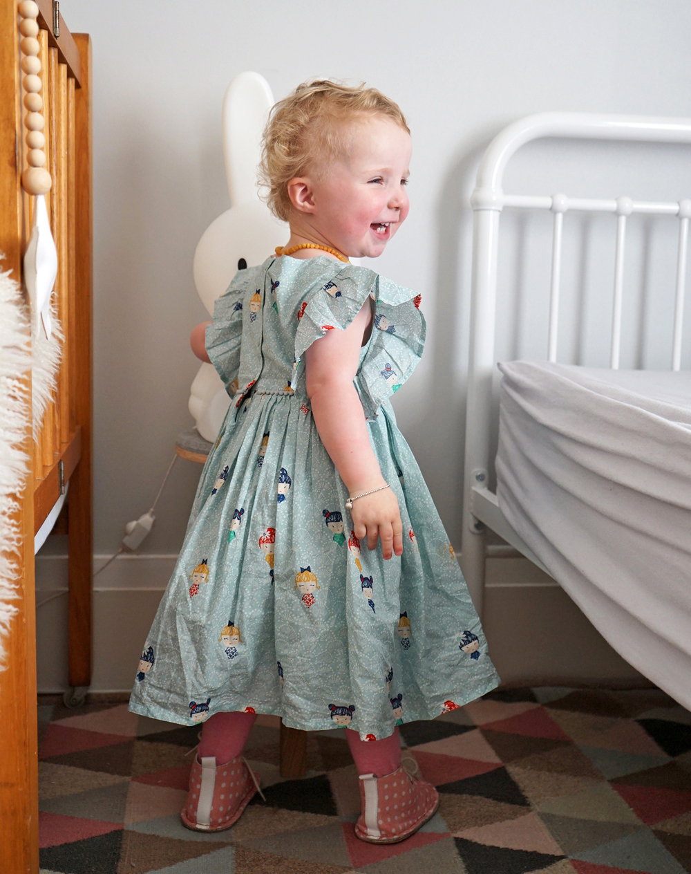 Freya wears  Marks & Spencer   Cotton Prom Dress  +  Tights .