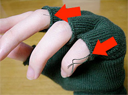stray threads exposed at the ends of hand warmer
