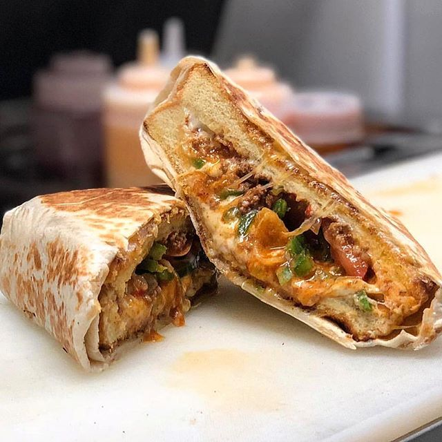 IT'S BAAAAACK! 😎😎😎 The EL JEFE is here for the month of May!! Get it while you can! 💃🏼🤤 . Ground Beef • Salsa • Jalapeños • Tomatoes • Sour Cream • Black Olives • Fritos • Chihuahua Cheese on Texas Toast & Wrapped in a Quesadilla  #ChzLyf
