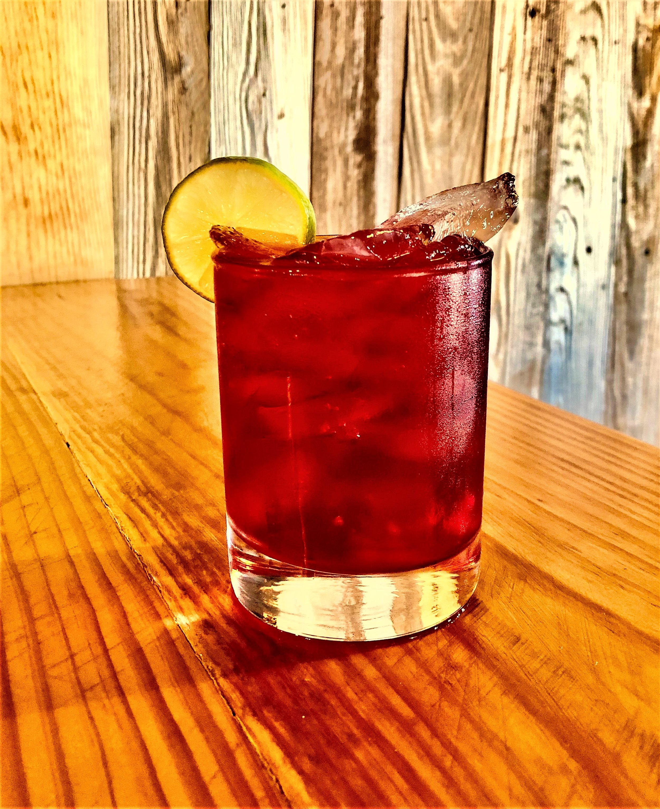 WRV CAPE COD   2 ounces of WILD RAG VODKA or WILD RAG MESQUITE BEAN VODKA 3 ounces Cranberry Juice 1/4 ounces of lime  Pour ingredients in a glass filled with ice. Garnish with key lime slice.
