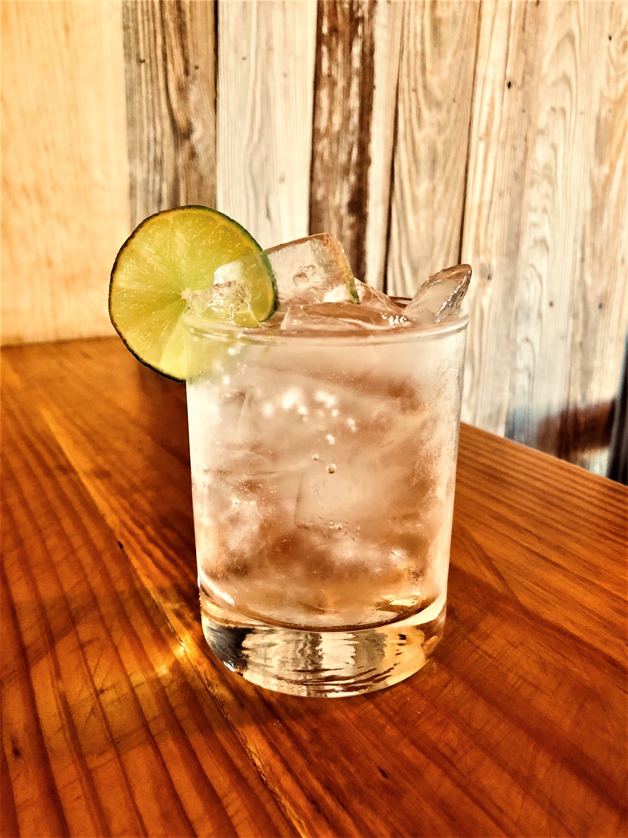 WRV TONIC   2 ounces of WILD RAG VODKA or WILD RAG MESQUITE BEAN VODKA 4 ounces Tonic Water  Fill glass with ice and add ingredients. Garnish with lime slice or wedge.