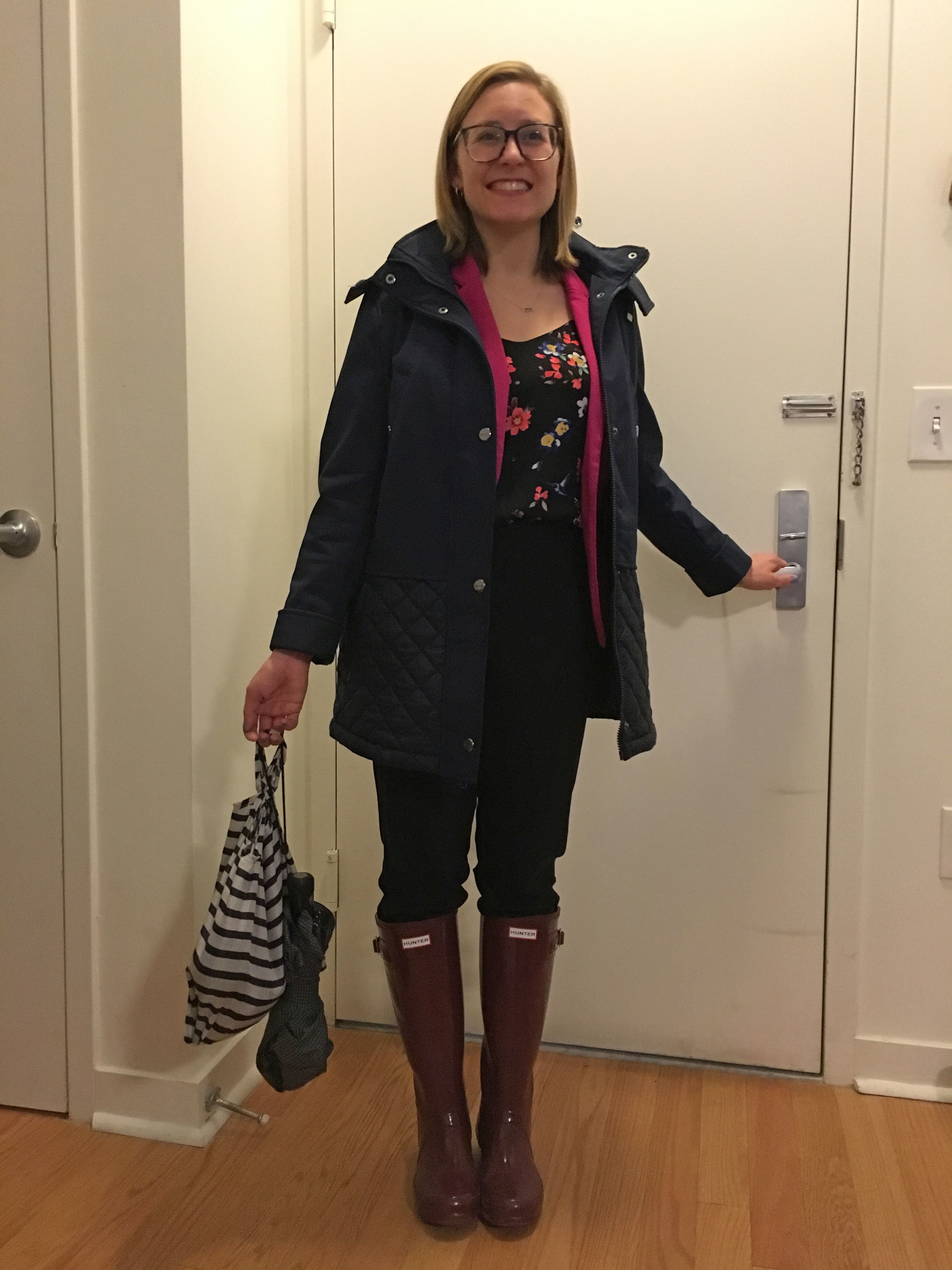 Commuting is real; protect your outfit to and from the office. Notice my shoe bag in hand with my umbrella.