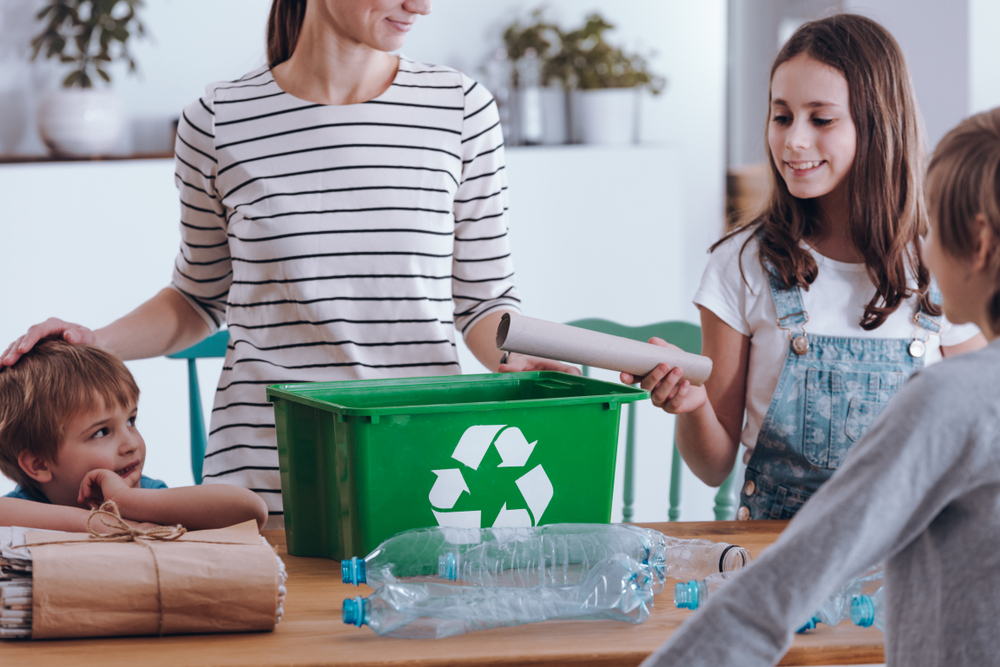 A mother teaching her children about recycling