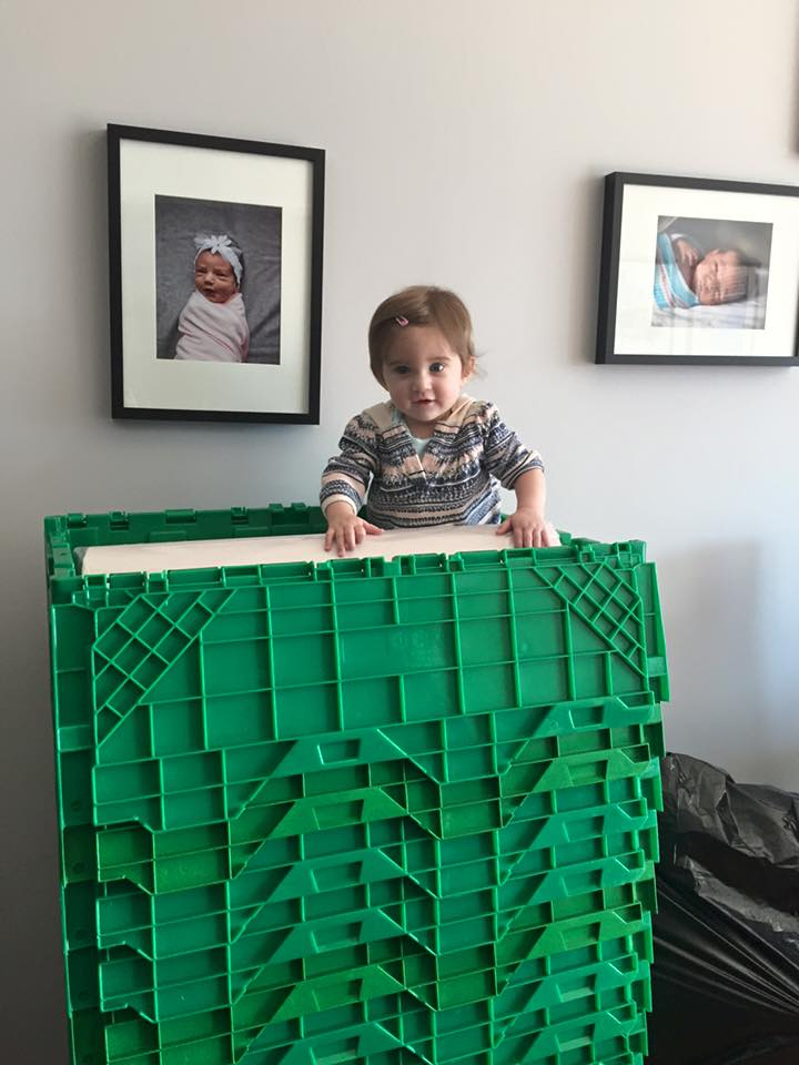 A child climbing a mountain of Chicago GreenBoxes