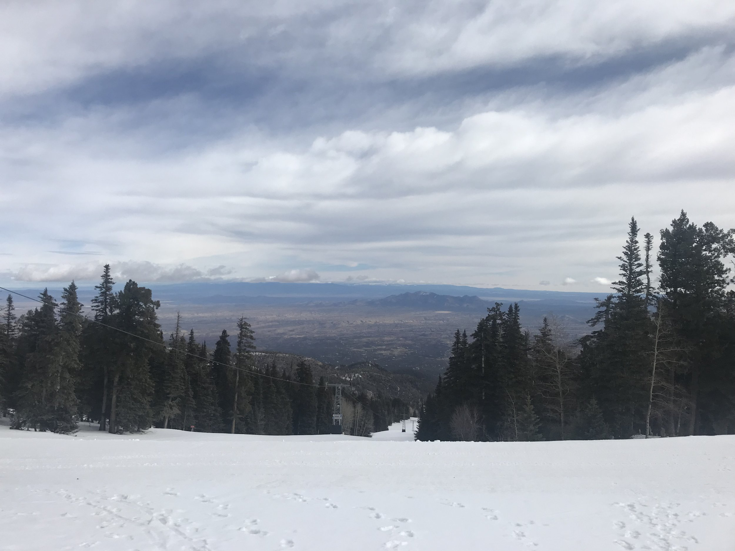 Skiing on the other side of the peak.