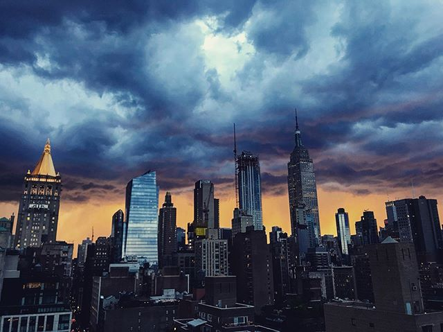 I noticed a glow outside and ran up to the roof to catch this thunderstorm sunset #timeoutnewyork #ilovenyc #sunsets #summer #glow #sky #weather #instapic #citylife  #tlpicks #rooftop
