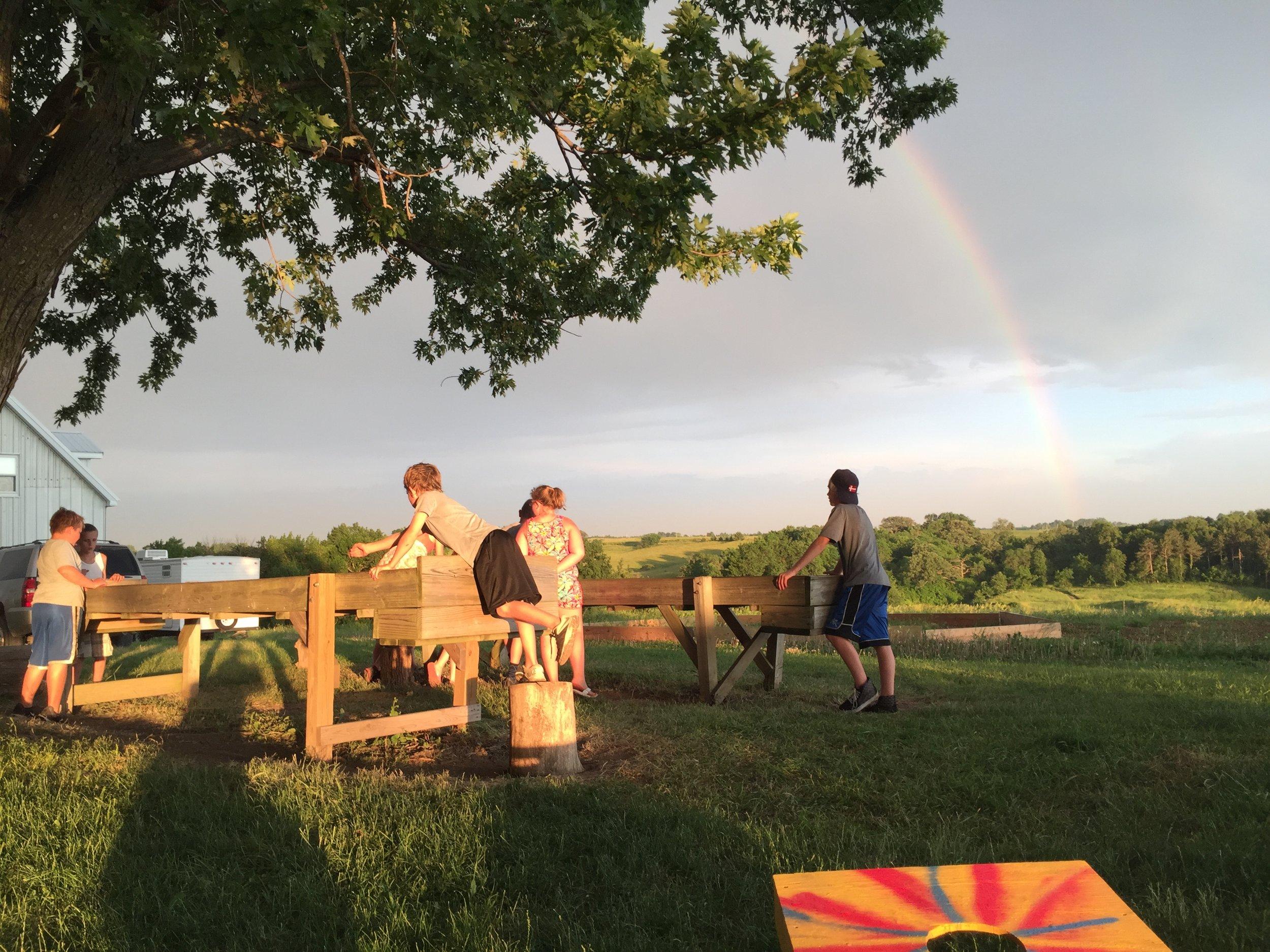 Evening sun, evening fun. And rainbow!