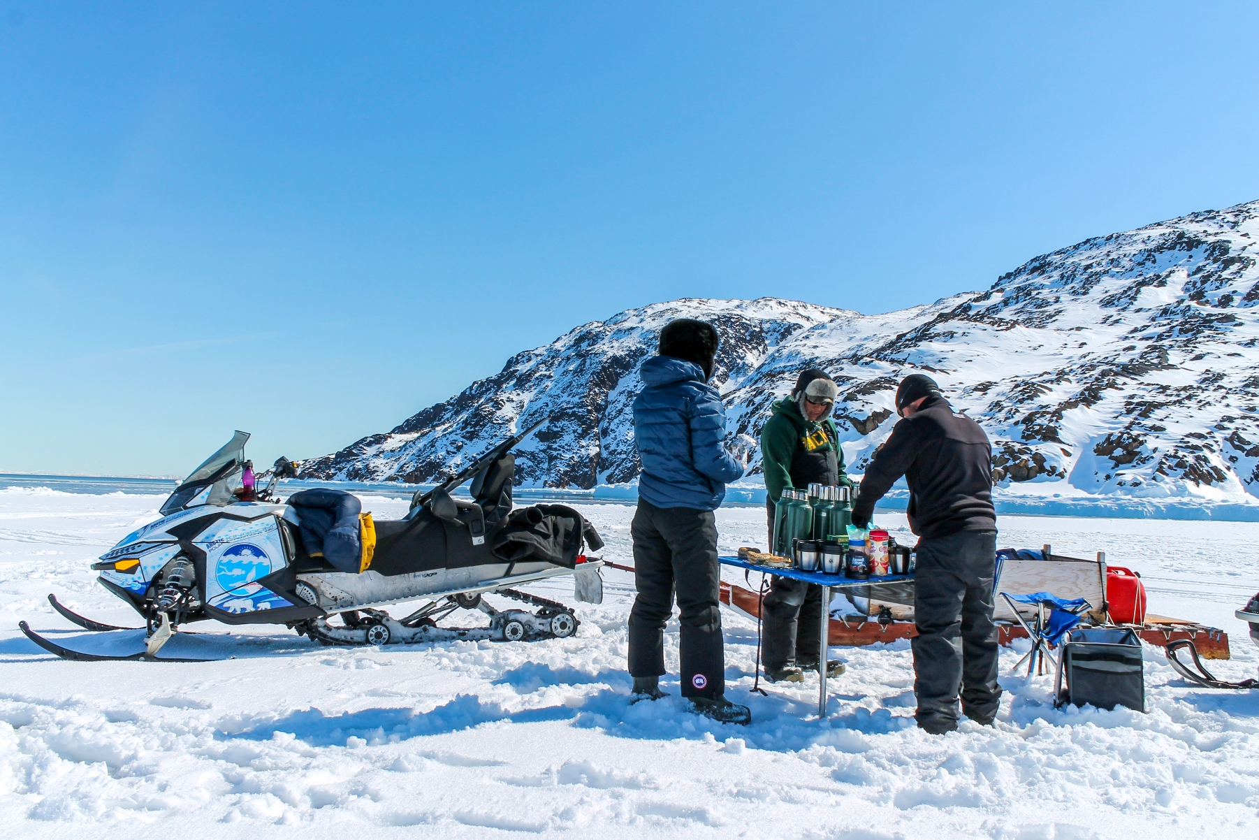 Host with the most! Tour Iqaluit staff setting up for lunch.