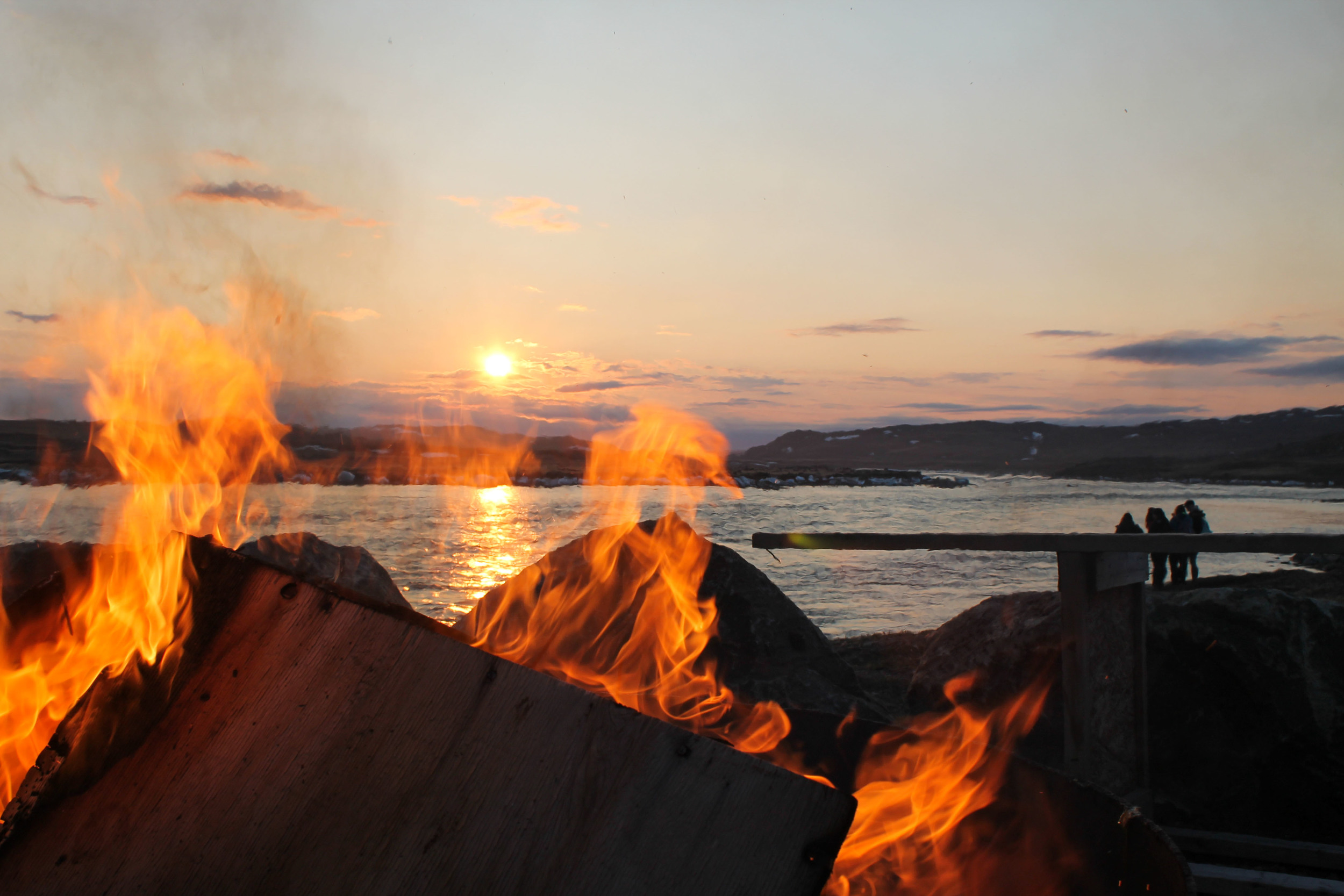 Bonfire blazing before the sun dipped (briefly) below the horizon.