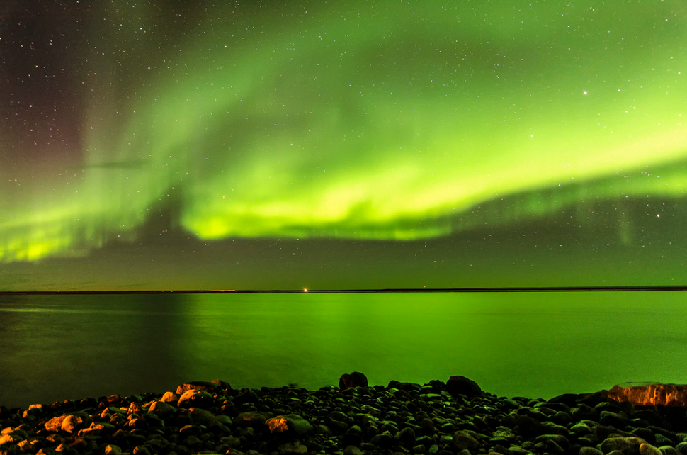 Northern lights over Arviat. https://www.flickr.com/photos/canadianson/11879983435/player/