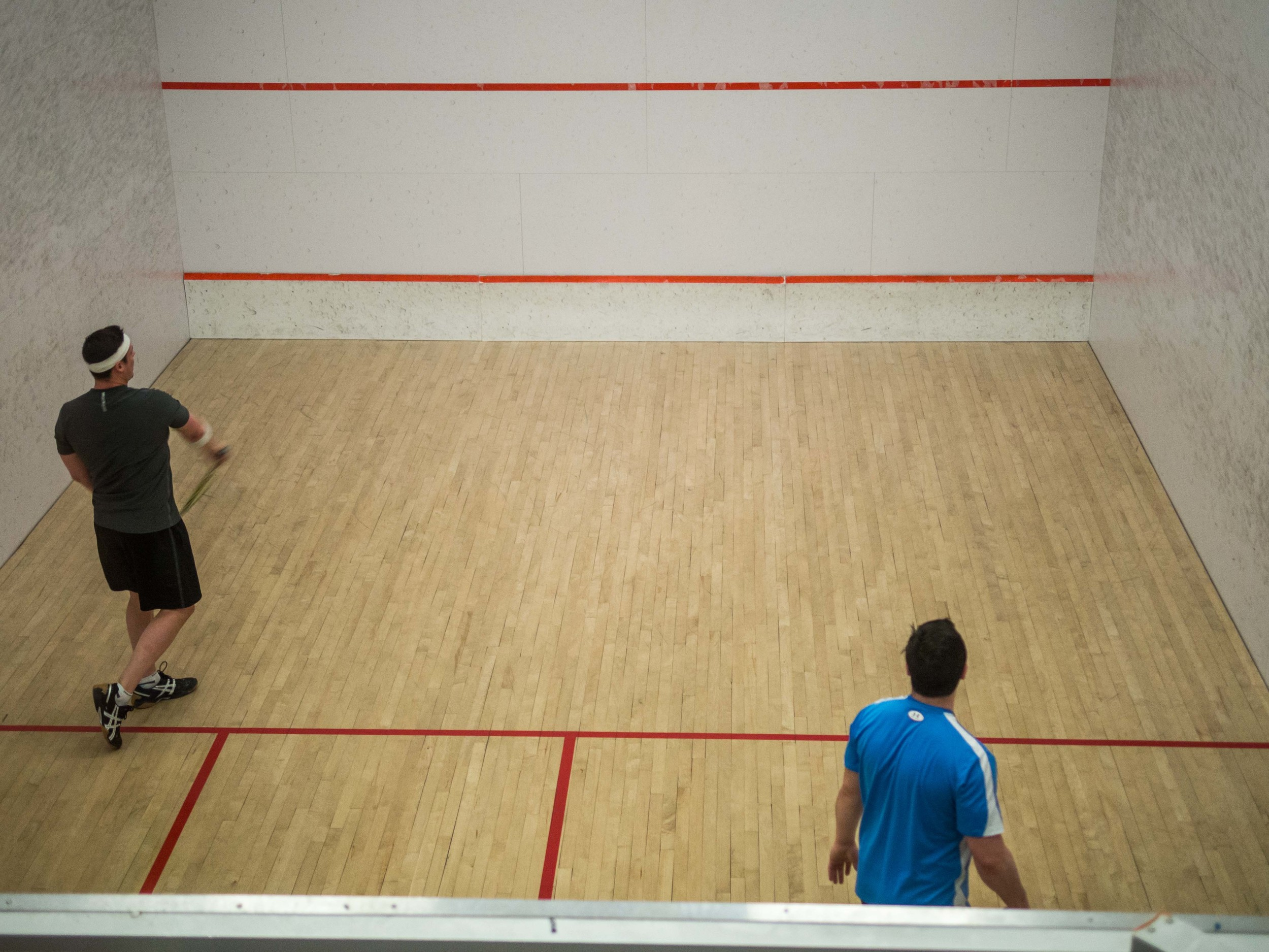 Ongoing squash match in one of the squash courts.