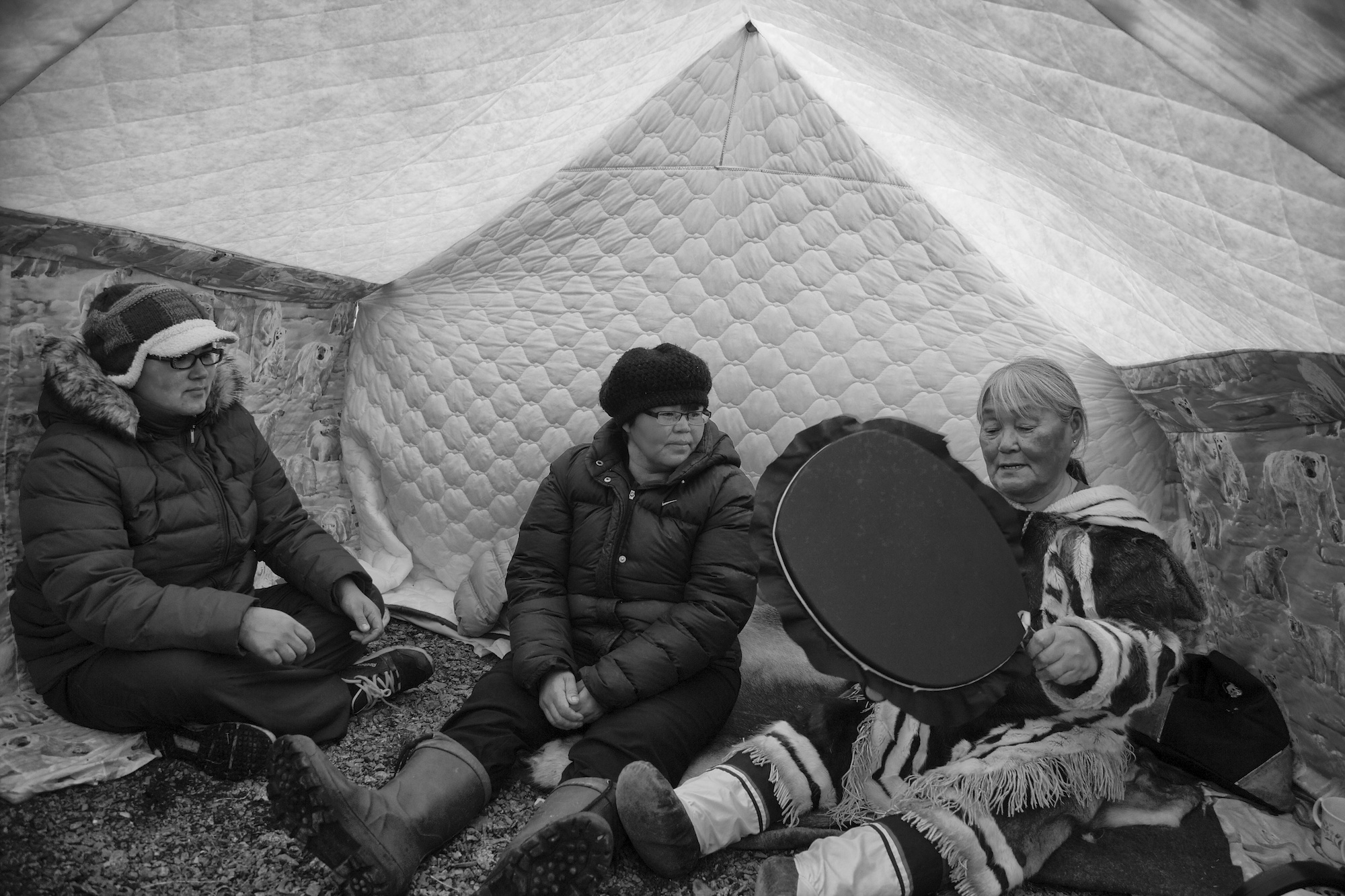 Drumming in a tent. Photo by Clare Kines.