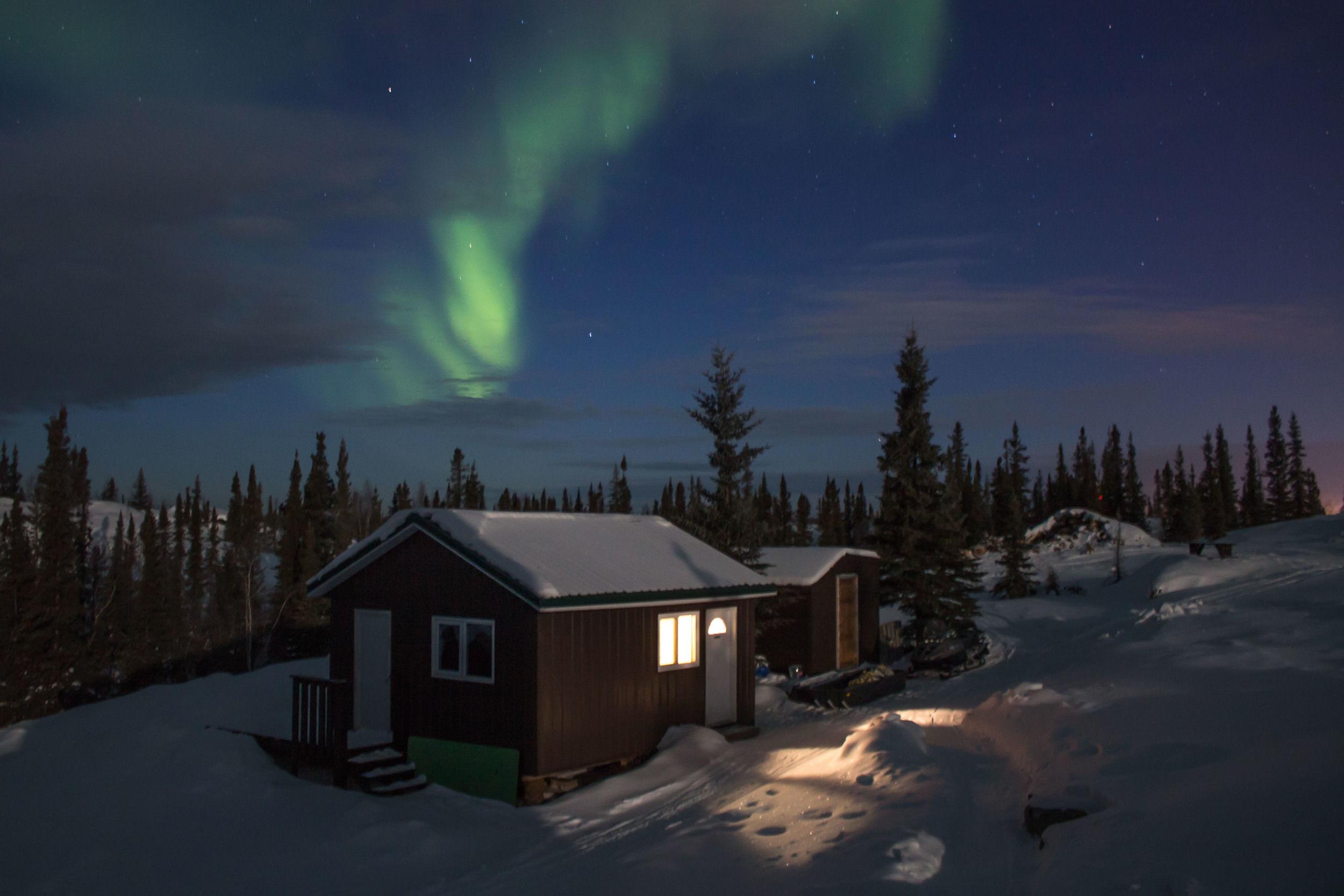 The aurora over another cluster of cottages. Photo by Sara Statham.