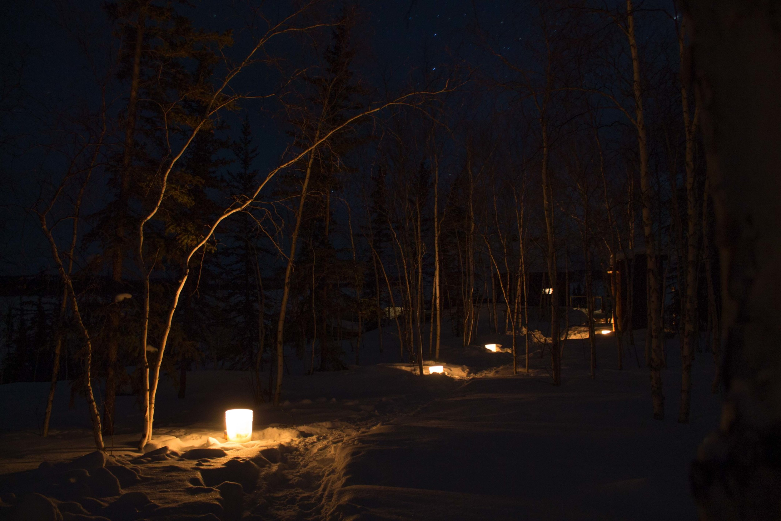 Lanterns lighting the way to the cabin. Photo by Sara Statham.
