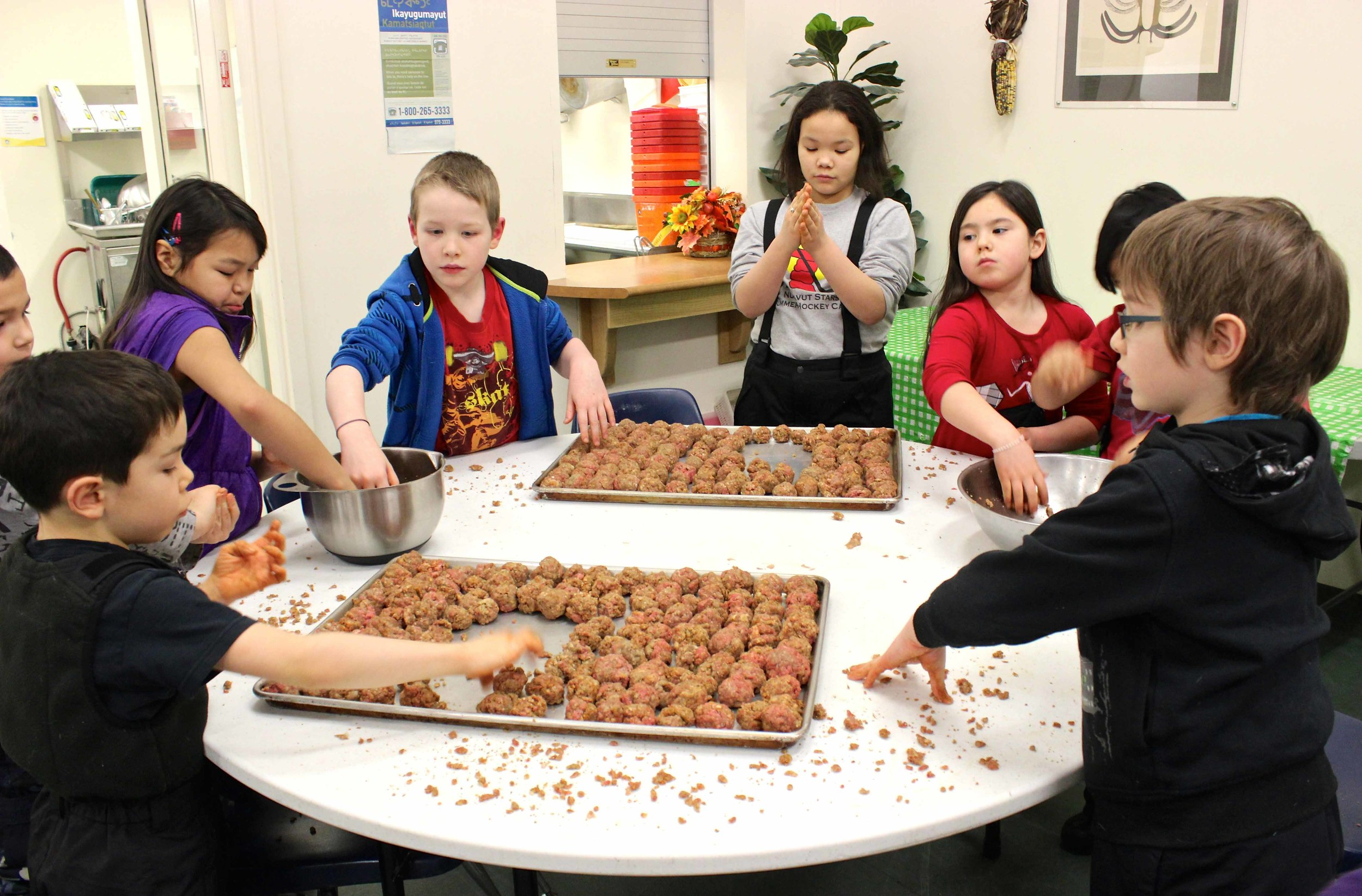 Students from Nanook Elementary School cooking program busy preparing almost 700 (!!) meatballs to serve for dinner. Photo by Sarah Brandvold.