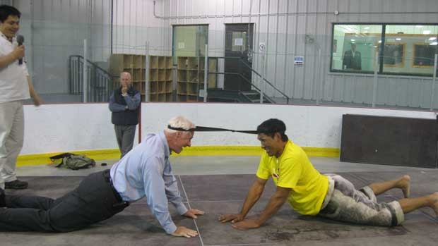 Gov. Gen. David Johnston tries the Inuit head pull competition with Johnny Issaluk. Photo from the CBC.