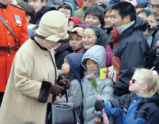 Hundreds of people lined up to meet Queen Elizabeth during her visit to Iqaluit in 2002. Photo from Nunatsiaq News.