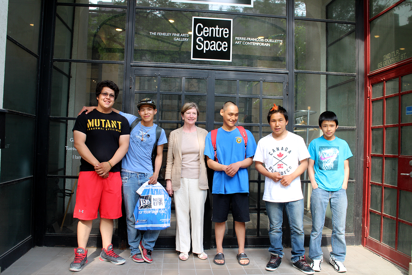 Parr, Cie, Audi, and Latch pose in front of Feheley Fine Arts Gallery with Patricia Feheley. Photo by Alexa Hatanaka.